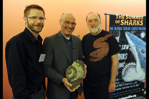 Leif Tapanila, from Idaho State University, Barrow, AK Geologist Richard Glenn and Ketchikan artist Ray Troll and the Helicprion fossil at the UAA ConocoPhillips Integrated Science building in Anchorage, AK on Wednesday, May 13, 2015. Anchorage geologist Richard Glenn found the buzz-tooth shark fossil Helicoprion on the North Slope when he was a student. The provenance of the fossil was lost when the Smithsonian miscategorized it. Troll was instrumental in having it found in the collection and getting Glenn credit for finding the only Helicprion fossil found in Alaska. The fossil will be on display at the Alaska SeaLife Center in Seward, AK this summer. Bob Hallinen / ADN