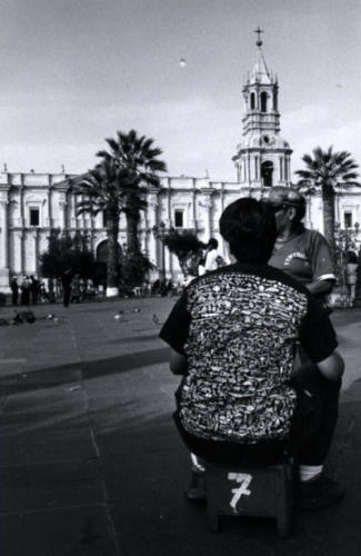 A 'Fabric of Life' shirt in a plaza somewhere in Peru