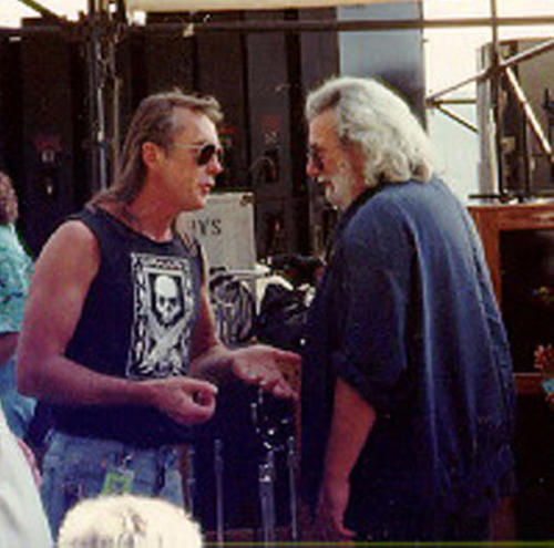 Jerry Garcia checks out Gary Duncan's shirt (Quicksilver Messenger Service)