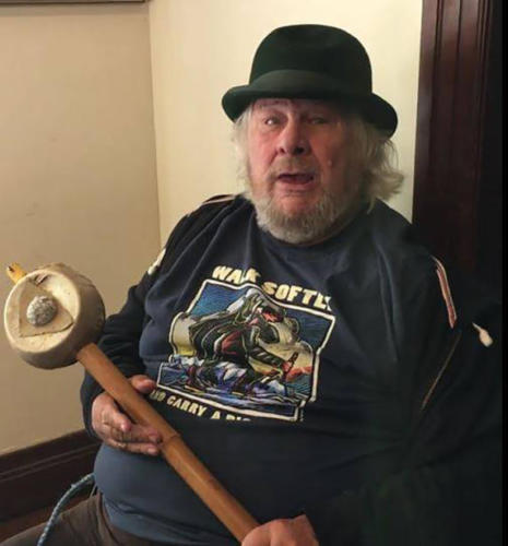 Wavey Gravy of Woodstock fame in a Walk Softly shirt