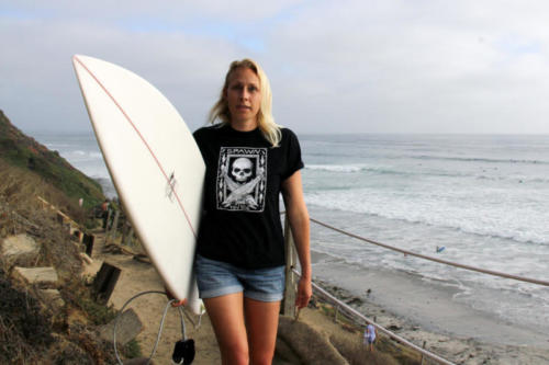 Oriana Poindexter rockin' a STYD shirt on a SoCal beach